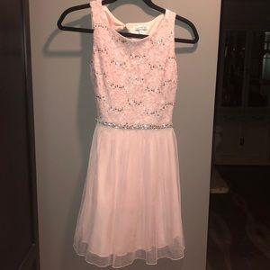 Soft and lightly sparkled blush dress